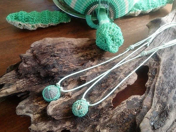 Sea urchin fossil and ghost net pendants